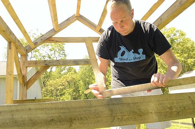 Joshua Farnsworth Using A Framing Square On A Timber Frame Building