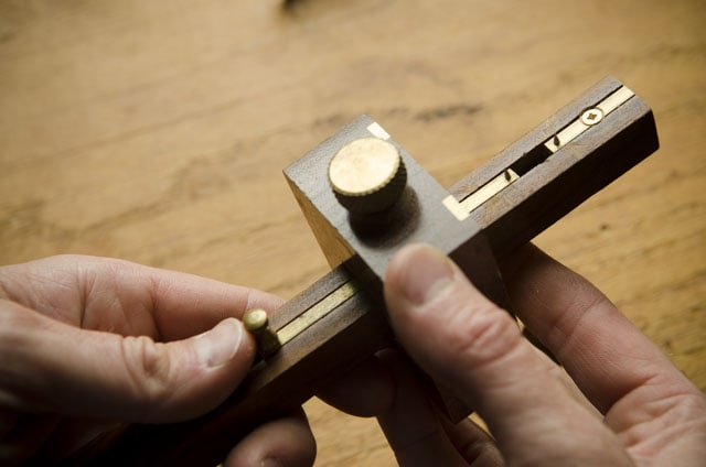 Crown Mortise Gauge Held Over A Roubo Woodworking Workbench