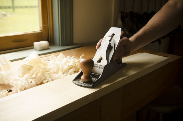 Woodriver Number 4 Bed Rock Style Smoothing Plane Sitting On A Roubo Workbench With Fine Shavings