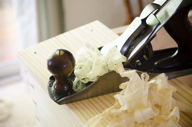 Stanley Bailey Number 4 Smoothing Plane With Shavings Hanging Out On A Pine Desk