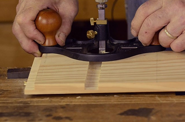 Woodworker Using A Lie-Nielsen Large Router Plane To Make A Dado Joint