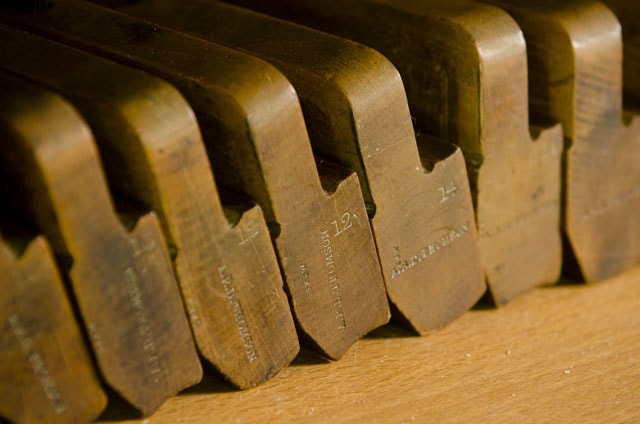 Closeup detail of maker's marks on hollows and rounds planes