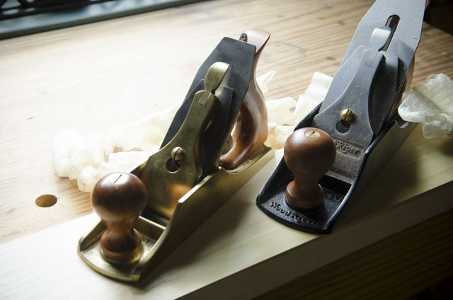 Lie-Nielsen Smoothing Plane Next To A Woodriver 4 1/2 Smoothing Plane With Wood Shavings