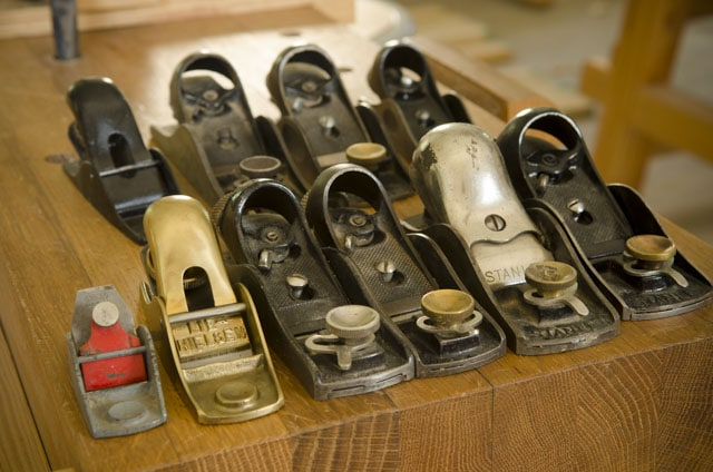 A Bunch Of Woodworking Block Planes Sitting On A Moravian Workbench