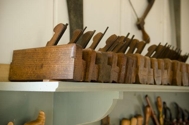 Row of molding planes on a shelf