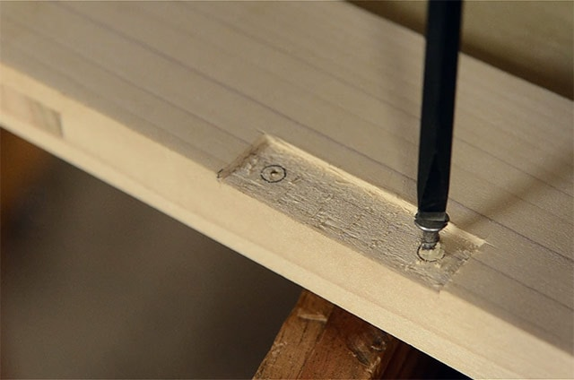 Driving A Screw While Installing Butt Hinges On The Lid Of A Dovetail Chest