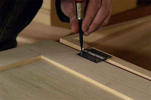 Driving Screws On A Chest Lid With A Screw Driver While Installing Butt Hinges On A Dovetail Chest