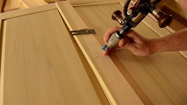 Woodworker Using A Egg Beater Drill To Bore Screw Holes Into Historical Hasp Hardware Installed On A Dovetail Chest