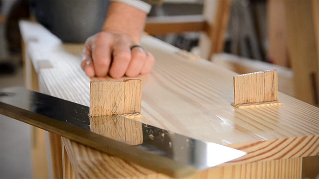 Cutting wooden wedges from mortise tenon joint with back saw