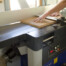 Joshua Farnsworth jointing a wide board on a Felder AD 941 jointer planer