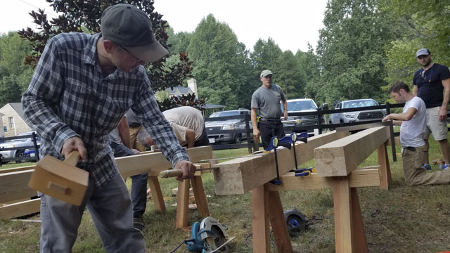 Wood And Shop Timber Framing Class Using Saw Bench Pair To Cut A Tenon With A Chisel
