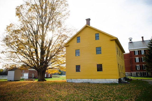 Hancock Shaker Village In Autumn With A Yellow House