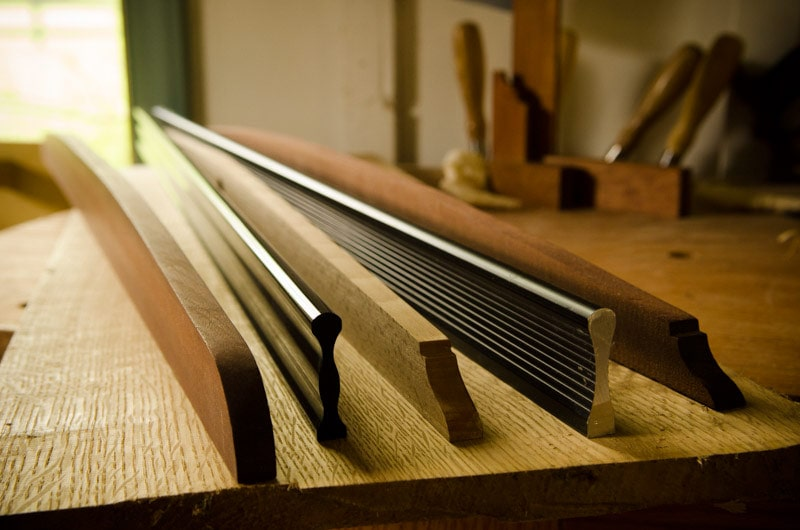 Woodworking Gauges Wooden And Metal Straight Edges Sitting On A Roubo Woodworking Workbench